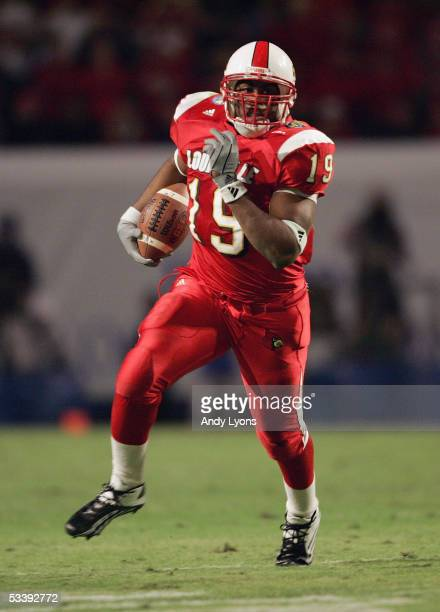 Running back Michael Bush of the Louisville Cardinals runs upfield against the Boise State Broncos during the AutoZone Liberty bowl at the Liberty...