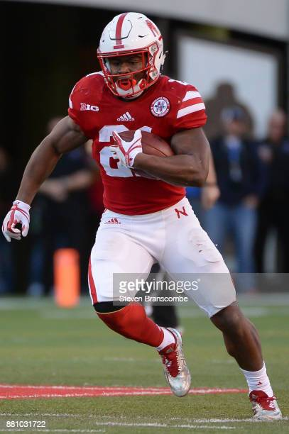 Running back Mikale Wilbon of the Nebraska Cornhuskers runs against the Iowa Hawkeyes at Memorial Stadium on November 24 2017 in Lincoln Nebraska