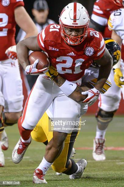Running back Mikale Wilbon of the Nebraska Cornhuskers runs from a tackle against the Iowa Hawkeyes at Memorial Stadium on November 24 2017 in...