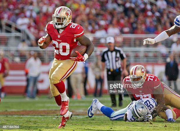 Running back Mike Davis of the San Francisco 49ers heads for a first down against the Dallas Cowboys in the first quarter of a preseason game on...