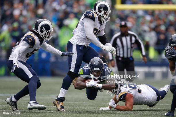Running back Mike Davis of the Seattle Seahawks dives in the second half against the Los Angeles Rams at CenturyLink Field on October 7 2018 in...