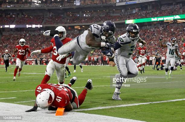 Running back Mike Davis of the Seattle Seahawks scores a 20yard touchdown over defensive back Antoine Bethea of the Arizona Cardinals during the...