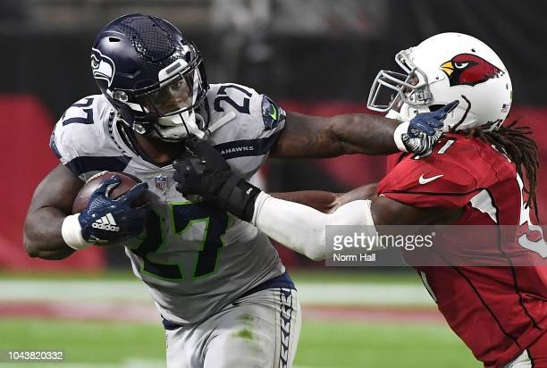 Running back Mike Davis of the Seattle Seahawks stiff arms linebacker Josh Bynes of the Arizona Cardinals during the second quarter at State Farm...
