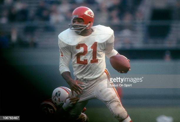Running back Mike Garrett of the Kansas City Chiefs carries the ball against the Boston Patriots during an NFL football game at Fenway Park circa...