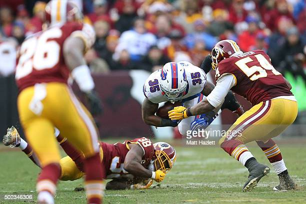 Running back Mike Gillislee of the Buffalo Bills carries the ball against linebacker Mason Foster and free safety Dashon Goldson of the Washington...