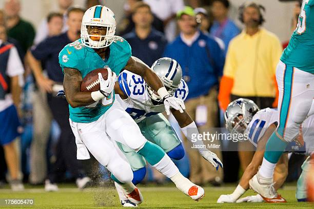 Running back Mike Gillislee of the Miami Dolphins runs out a pass reception for a gain against the Dallas Cowboys during the second quarter at...
