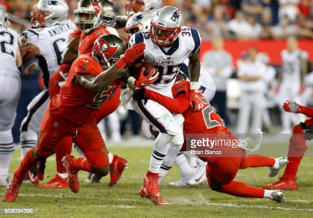 Running back Mike Gillislee of the New England Patriots runs for a gain of six yards against middle linebacker Kendell Beckwith of the Tampa Bay...