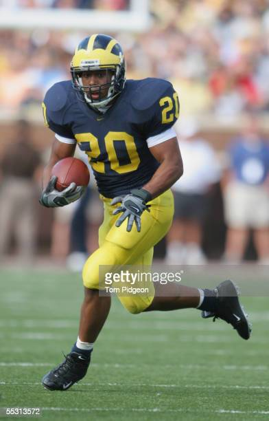 Running back Mike Hart of the Michigan Wolverines runs the ball against the Northern Illinois Huskies during the game at Michigan Stadium on...
