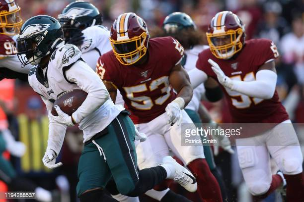 Running back Miles Sanders of the Philadelphia Eagles rushes past inside linebacker Jon Bostic of the Washington Redskins during the fourth quarter...
