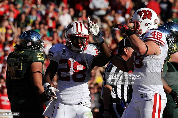 Running back Montee Ball of the Wisconsin Badgers celebrates after scoring ona four-yard touchdown run in the second quarter against the Oregon Ducks...