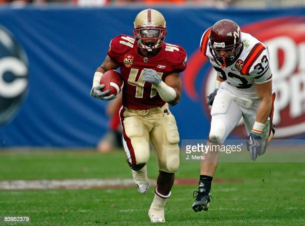 Running back Montel Harris of the Boston College Eagles runs the ball against the Virginia Tech Hokies in the 2008 ACC Football Championship game at...