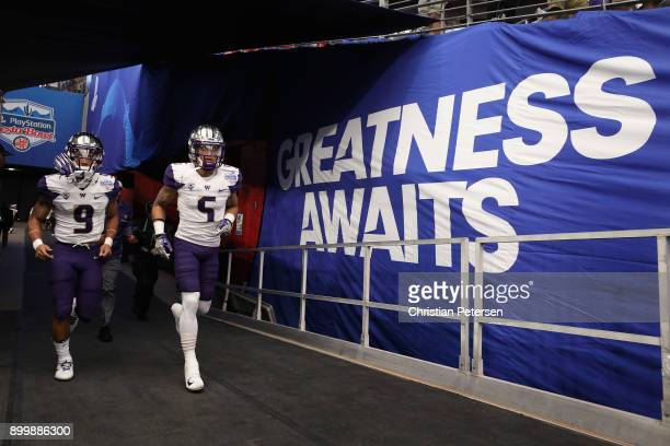 Running back Myles Gaskin and wide receiver Andre Baccellia of the Washington Huskies run out onto the field before the Playstation Fiesta Bowl...
