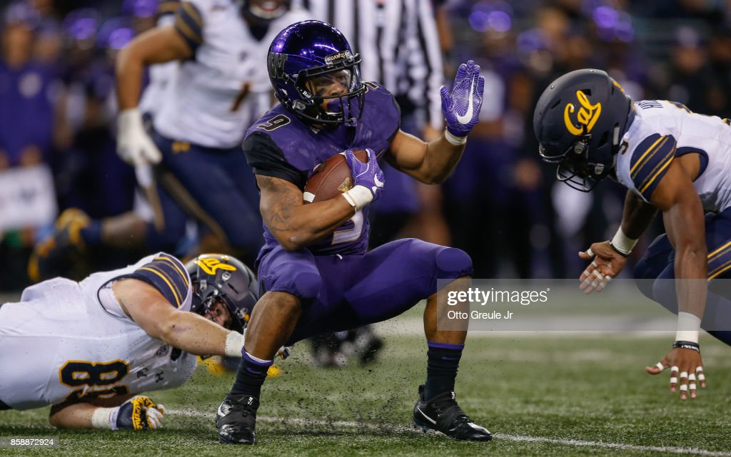 Running back Myles Gaskin #9 of the Washington Huskies rushes against the California Golden Bears at Husky Stadium on October 7, 2017 in Seattle, Washington.