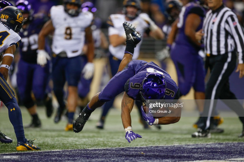 Running back Myles Gaskin #9 of the Washington Huskies scores a touchdown in the fourth quarter against the California Golden Bears at Husky Stadium on October 7, 2017 in Seattle, Washington.