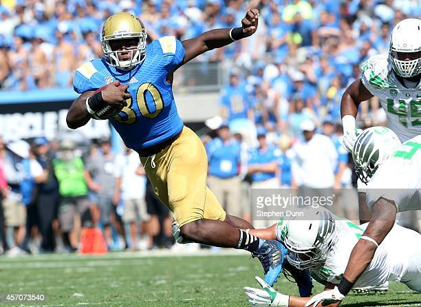 Running back Myles Jack of the UCLA Bruins carries the ball against the Oregon Ducks at the Rose Bowl on October 11 2014 in Pasadena California...