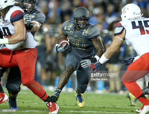 Running back Myles Jack of the UCLA Bruins carries the ball against the Arizona Wildcats at the Rose Bowl on November 1 2014 in Pasadena California