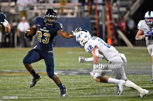 FIU running back NapoleonMaxwell evades Middle Tennessee safety Reed Blankenship while carrying the ball in the fourth quarter as the FIU Golden...