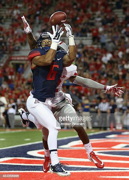 Running back Nate Phillips of the Arizona Wildcats is unable to catch a pass in the end zone guarded by defensive back Mike Horsey of the UNLV Rebels...