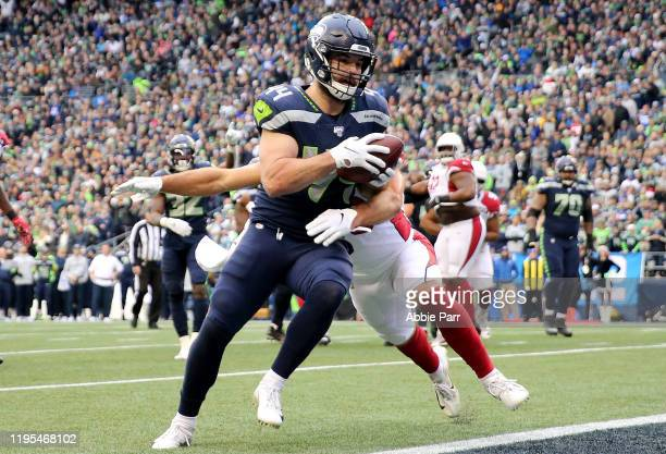 Running back Nick Bellore of the Seattle Seahawks rushes for a touchdown over Arizona Cardinals in the first quarter of the game at CenturyLink Field...