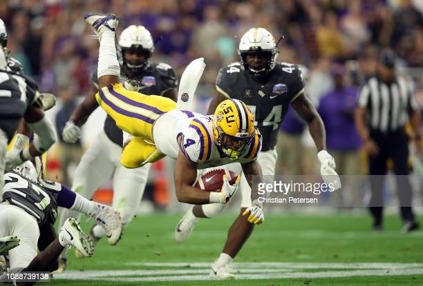 Running back Nick Brossette of the LSU Tigers is tackled by defensive back Richie Grant of the UCF Knights during the first quarter of the...