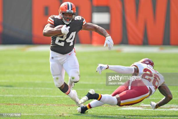 Running back Nick Chubb of the Cleveland Browns breaks a tackle from strong safety Landon Collins of the Washington Football Team as he runs for a...