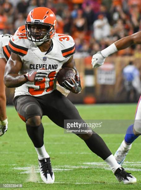 Running back Nick Chubb of the Cleveland Browns carries the ball in the fourth quarter of a preseason game against the Buffalo Bills at FirstEnergy...
