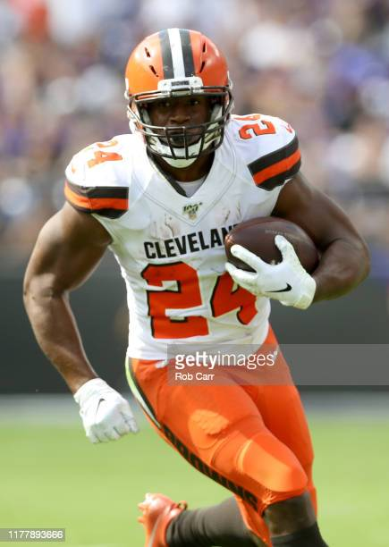 Running back Nick Chubb of the Cleveland Browns carries the ball during the first quarter of the game against the Baltimore Ravens at MT Bank Stadium...