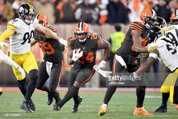 Running back Nick Chubb of the Cleveland Browns finds a hole in the line during the second half against the Pittsburgh Steelers at FirstEnergy...