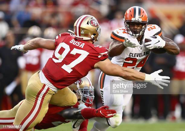 Running back Nick Chubb of the Cleveland Browns is tackled by Nick Bosa of the San Francisco 49ers during the game at Levi's Stadium on October 07...