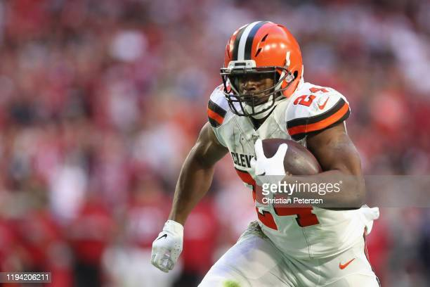 Running back Nick Chubb of the Cleveland Browns rushes the football against the Arizona Cardinals during the first half of the NFL game at State Farm...