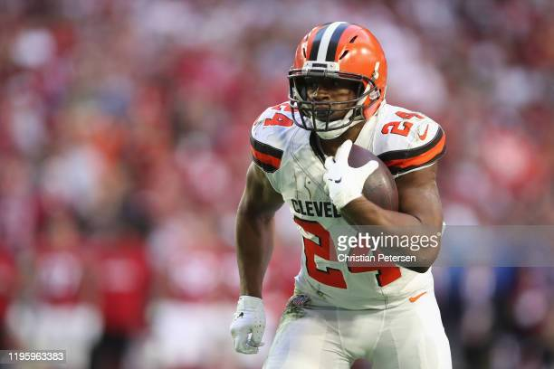 Running back Nick Chubb of the Cleveland Browns rushes the football against the Arizona Cardinals during the NFL game at State Farm Stadium on...