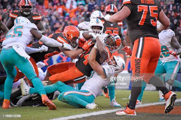 Running back Nick Chubb of the Cleveland Browns scores a touchdown over linebacker Vince Biegel of the Miami Dolphins during the second half at...