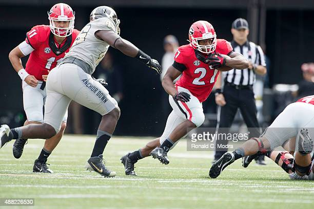 Running back Nick Chubb of the Georgia Bulldogs carries the ball against the Vanderbilt Commodores at Vanderbilt Stadium on September 12 2015 in...