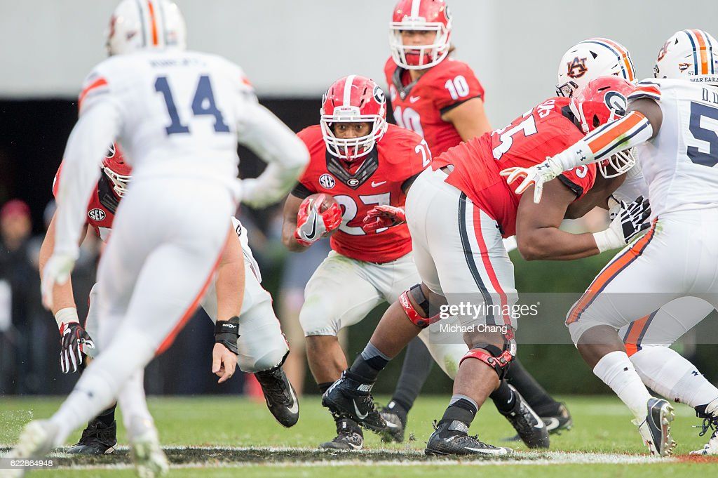Running back Nick Chubb #27 of the Georgia Bulldogs looks to run the ball through traffic during their game against the Auburn Tigers at Sanford Stadium on November 12, 2016 in Athens, Georgia.