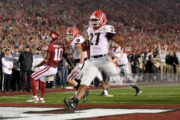 Running back Nick Chubb of the Georgia Bulldogs scores on a twoyard touchdown run late in the fourth quarter against the Oklahoma Sooners in the 2018...