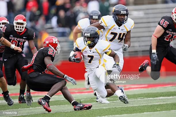 Running back Noel Devine of the West Virginia Mountaineers runs against Devin McCourty of the Rutgers University Scarlet Knights on October 27 2007...