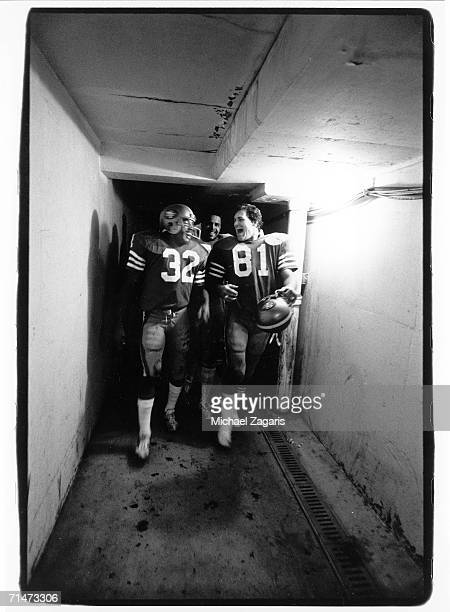 Running back O.J. Simpson and tight end Ken McAfee of the San Francisco 49ers share a laugh as they walk through the tunnel during a game in the 1979...