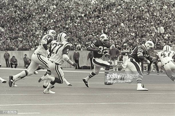Running back OJ Simpson of the Buffalo Bills runs behind the blocking of offensive lineman Joe DeLamielleure during a game against the New York Jets...