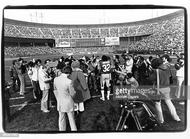 Running back OJ Simpson of the San Francisco 49ers addresses the crowd before his final home game against the Tampa Bay Buccaneers at Candlestick...