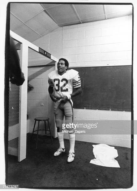 Running back OJ Simpson of the San Francisco 49ers gets dressed in the locker room before the final game of his career against the Atlanta Falcons at...