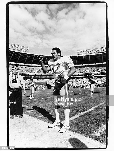 Running back O.J. Simpson of the San Francisco 49ers salutes the crowd before his final game against the Atlanta Falcons at Fulton County Stadium on...