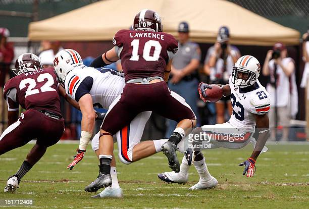 Running back Onterio McCalebb of the Auburn Tigers tries to cut back against Mississippi State Bulldogs in the first quarter of a NCAA college...