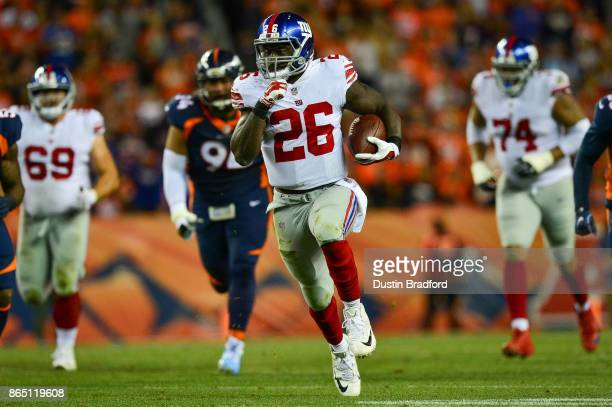 Running back Orleans Darkwa of the New York Giants breaks out for a long run against the Denver Broncos in the second quarter of a game at Sports...