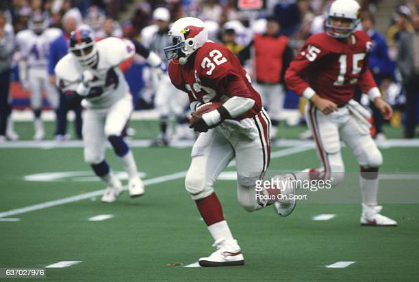 Running back Ottis Anderson of the St Louis Cardinals carries the ball against the New York Giants during an NFL football game December 13 1981 at...