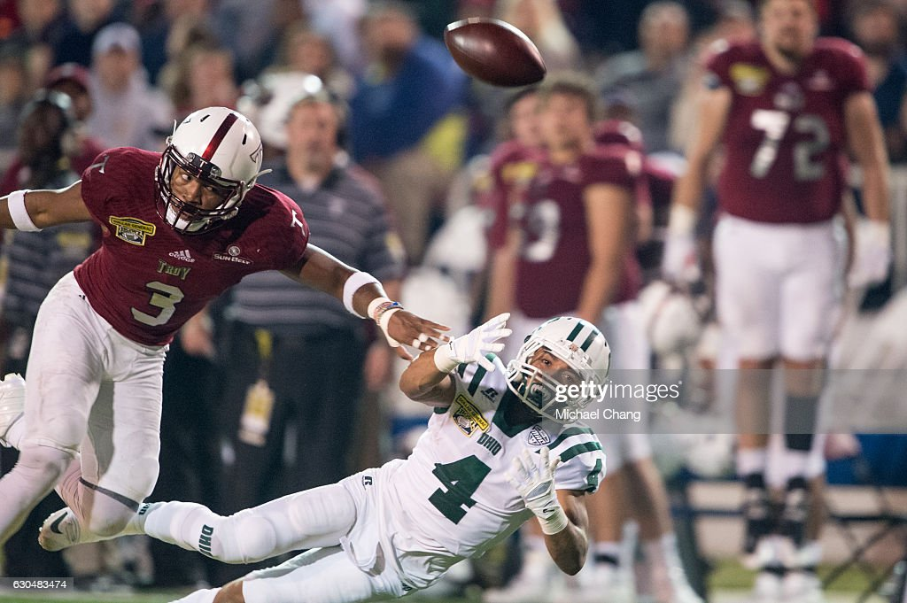 Running back Papi White #4 of the Ohio Bobcats attempts to catch a pass in front of safety Kris Weatherspoon #3 of the Troy Trojans on December 23, 2016 in Mobile, Alabama. The Troy Trojans defeated the Ohio Bobcats 28-23.