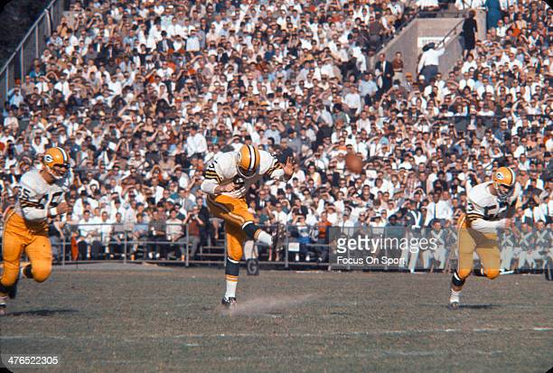 Running back Paul Hornung of the Green Bay Packers kicks off against the Baltimore Colts during an NFL football game October 28 1962 at Memorial...