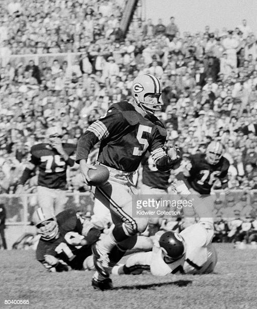 Running back Paul Hornung of the Green Bay Packers runs with the ball during a game on September 25 1960 against the Chicago Bears at Lambeau Field...