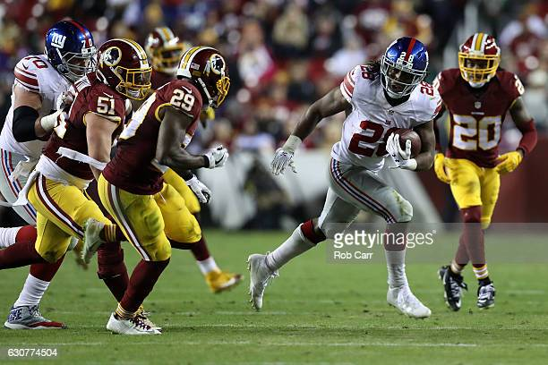 Running back Paul Perkins of the New York Giants carries the ball against free safety Duke Ihenacho and inside linebacker Will Compton of the...