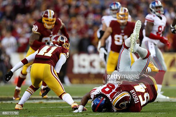 Running back Paul Perkins of the New York Giants is tackled by inside linebacker Mason Foster of the Washington Redskins in the first quarter at...