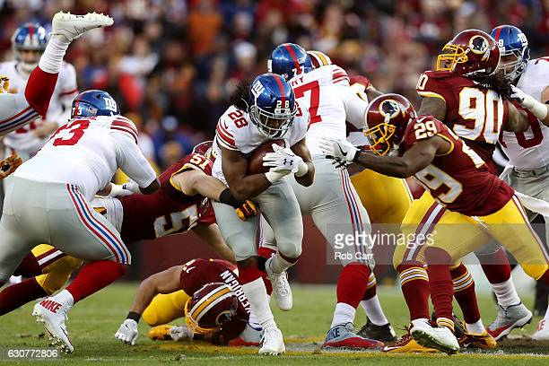 Running back Paul Perkins of the New York Giants is tackled by inside linebacker Will Compton of the Washington Redskins in the first quarter at...